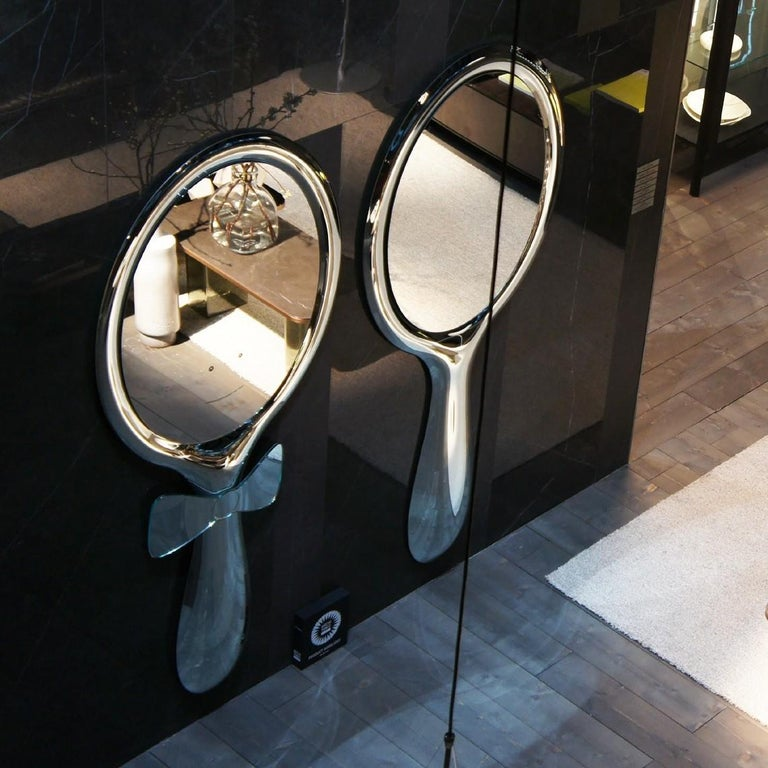Freestanding or hanging mirror, in 8 mm-thick melted and back-silvered glass; 5 mm-thick flat mirror.