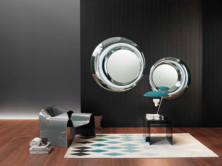 Wall mirror in 8 mm-thick fused and back-silvered glass; 5 mm-thick flat mirror. Rear mounting panel allowing hanging in various positions.