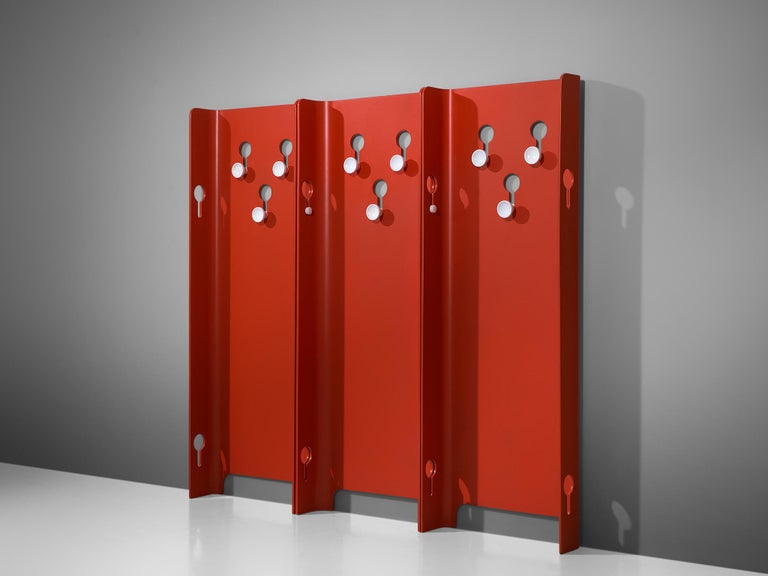 Set of five red hall stands by Carlo De Carli for Fiarm, 1960s  Large set of red lacquered coat racks, designed by Carlo de Carli for Fiarm in the 1960s. Each hall stand is executed with white knobs to hang your garments and accessories. The knops