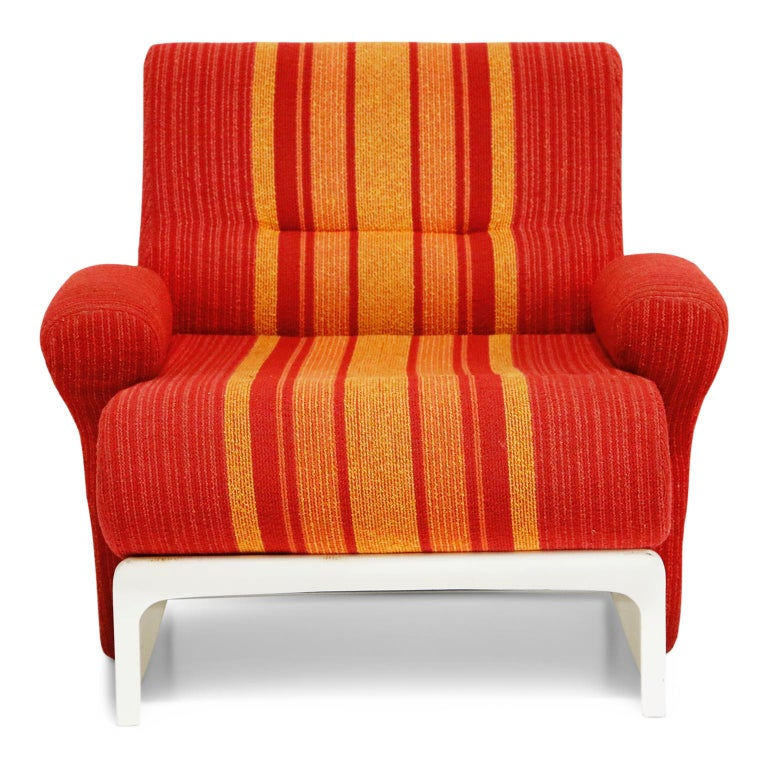 An incredible set of 1960s fiberglass lounge chairs by Ernst Moeckl, sourced from a boutique hotel on the Baltic Sea, these fantastic scoop armchairs feature red, orange and yellow striped fabric that is in very good condition and is ready to be