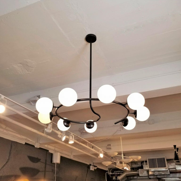 The Fibonacci 9 chandelier: Handmade to order by Blueprint Lighting, this large round 9 globe brass chandelier is absolutely gorgeous and bridges the gap between modern and traditional design.   The height and width can be customized to suit any