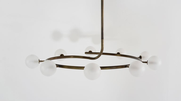 Fibonacci bridges the gap between modern and traditional design.  Shown in bronze with frosted glass globes, 44 inches in diameter.  This piece is also fully customizable with a 5-6 week lead time. Drop rod and diameter can be adjusted. Number