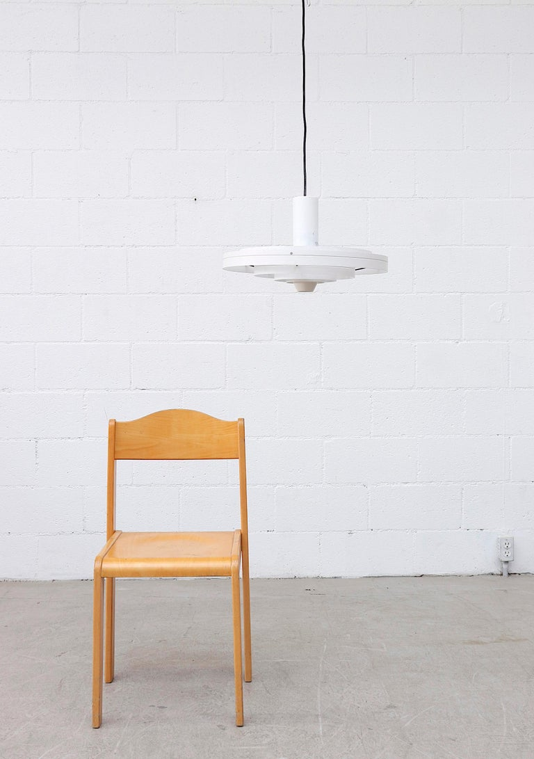 Award-Winning 'Fibonacci' UFO pendant light with white enameled with black enameled metal accents by Sophus Frandsen for Fog & Mørup, Denmark, 1963. In original condition with visible wear and scratching, consistent with its age and usage.