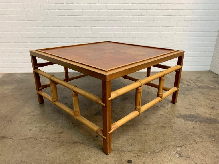Nice combination of walnut, rattan and patchwork leather top under glass.