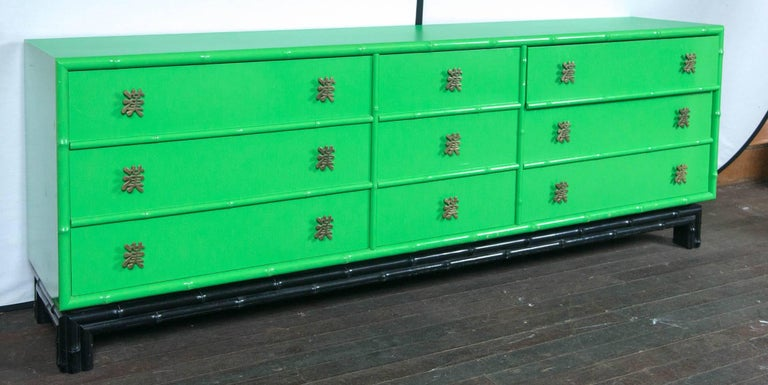 Ficks Reed Asian- chinoiserie faux bamboo chest of drawers or credenza in original parrot green and black with Chinese characters for pulls.