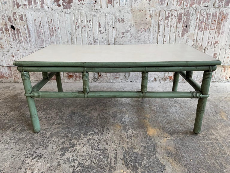 Midcentury rattan bamboo coffee table by Ficks Reed features a gorgeous green frame and a perfect amount of patina from age. Very good vintage condition. We also have other matching pieces, just check our other listings.