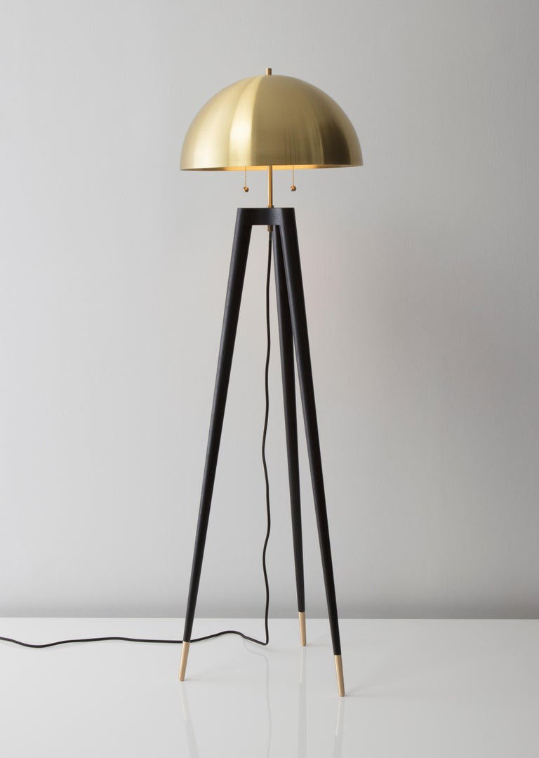 • Fife tripod lamp is lathe turned from solid walnut. The shade is spun from solid brass with a satin finish.  • A black fabric covered cord hangs loosely from center of lamp. • Standard cord length is 12 feet. Cord on 220V fixtures available in