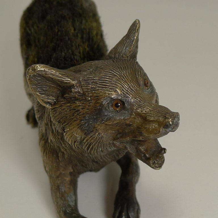A fabulous novelty pen / nib wipe cast in bronze as a running Fox, beautifully executed and sporting his two glass eyes.  The underside is stamped twice