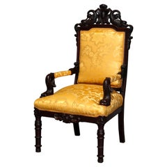 Figural Baroque Style Carved Rosewood Armchair, Fleur-de-Lis and Dolphins