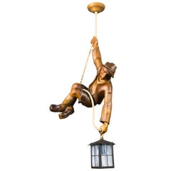 Figural Pendant Light of a Hand Carved Wood Figure Mountain Climber with Lantern