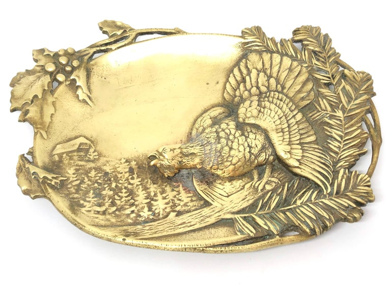 Gorgeous bronze figural catchall with a wood grouse and mountain motif . It's a beautiful piece for every sideboard or just for your desk. Made in the 1920s this beautiful decorative piece is an addition to every room.