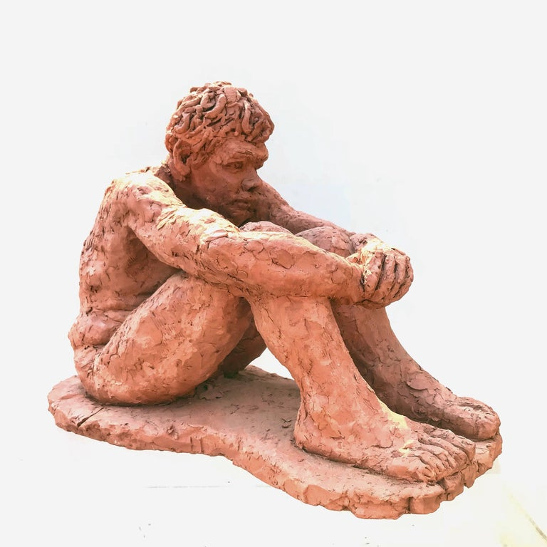 A good looking modern clay sculpture of a seated young man. Great movement and scale throughout the work. The subject, slightly consumed in thought is captivating.  Signed,