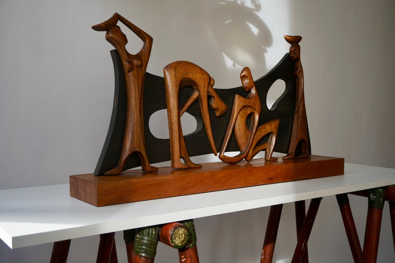 Highly rare and decorative elegant scene in wood of a man making respectfully advances to a lady, with female servants bringing food. Made in Congo in the 20th century, and offered by the Belgium Government to the City of Brasilia, at its