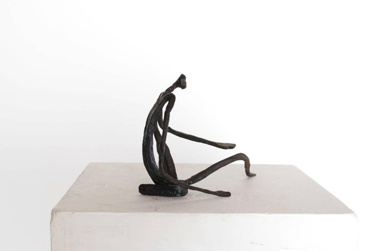 Lyrical and graphic figurative sculpture by Salvino Marsura. hand-forged and textured wrought iron is skilfully manipulated into an elegant, fluid, filigree figure.  Made in Italy.