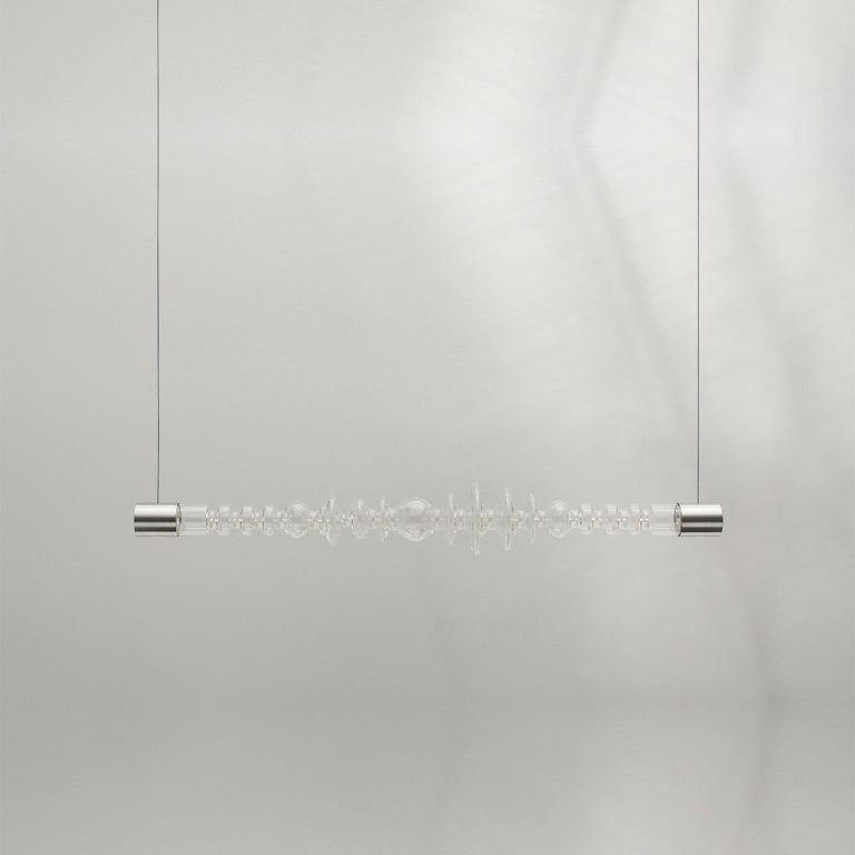 The Filamento light was designed as a modular system. Each of the 1.26-metre-long lights can be attached to one another. The studio attached four Filamento pieces together to form a five-metre-long installation for Rossana Orlandi's space. The light
