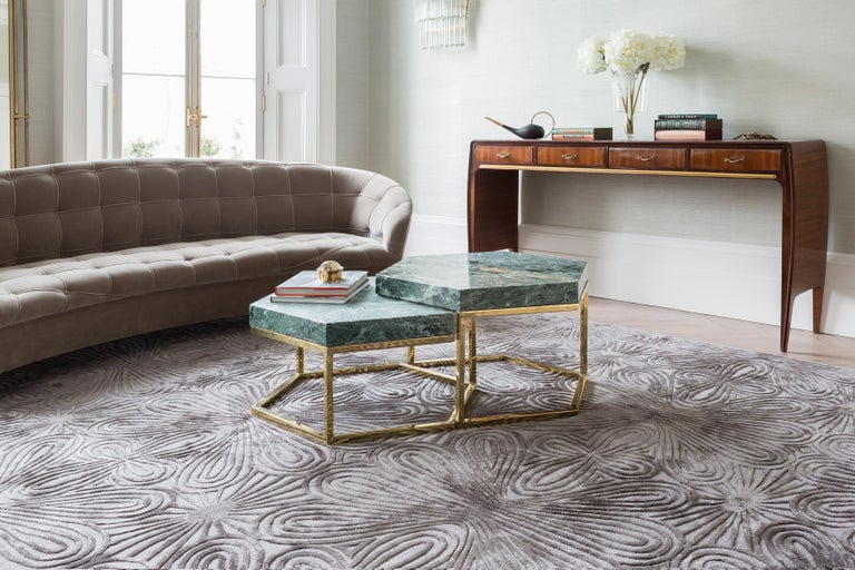 Rich in dimension and texture, this design features an interlocking graphic motif of curves which are Hand-knotted in raised silk. The sinuous lines entwine giving the impression of movement and fluidity. Hand-knotted Tibetan wool and silk.