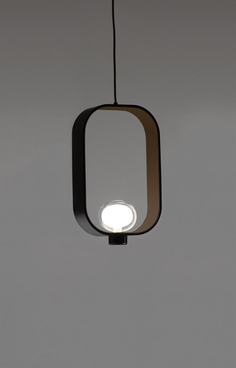 Inspired by the classic Chinese lanterns, the particular bi-dimensional structure is made by powder coated painted metal on the outside, while the inside color is sand grey. The light source is located inside a double-side borosilicate glass