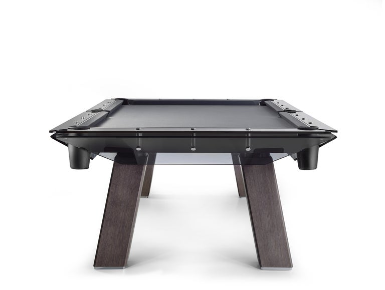 Filotto wood edition billiard table gives a new life, new characteristics, and new values to a Classic product. The design, construction, and workmanship of this work of genius are all Italian, showcasing the highest expression of technological