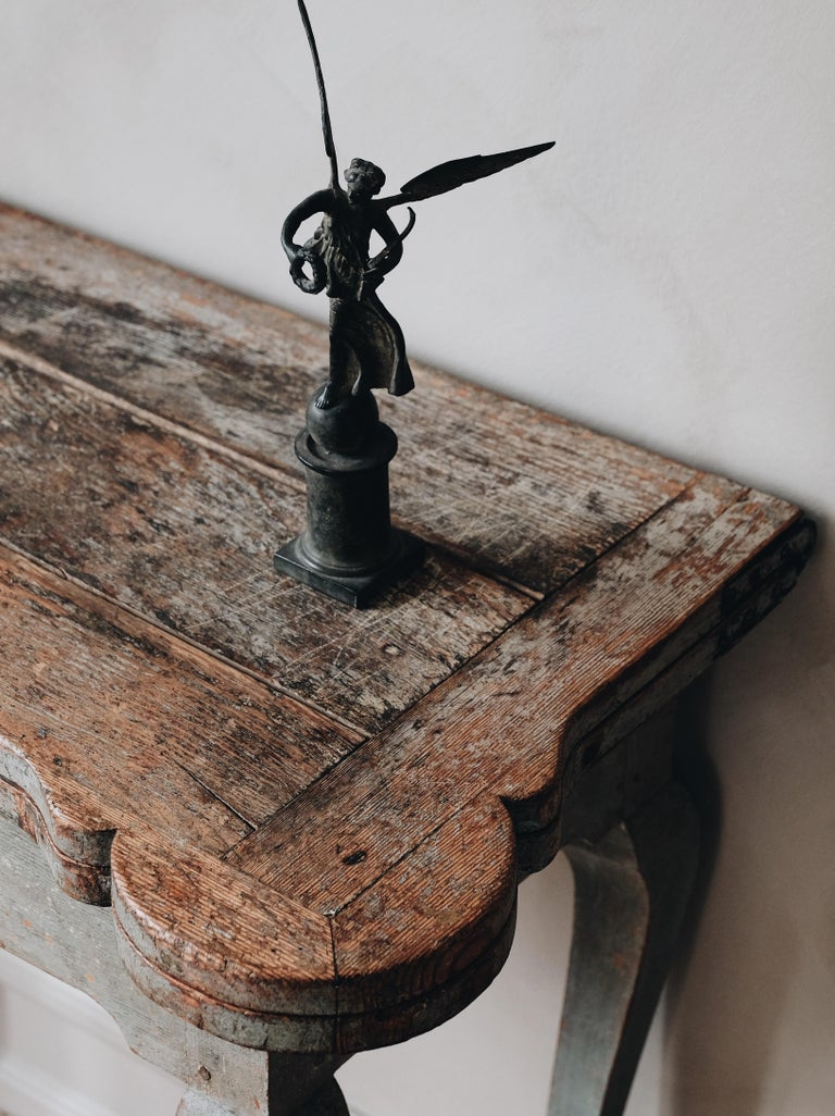 Exceptional and most unusual Swedish 18th century early Rococo console and gaming table in its original color with great patination to the surface. The top lifts to reveal an interior with candle stands and guinea cups.  Good condition with one
