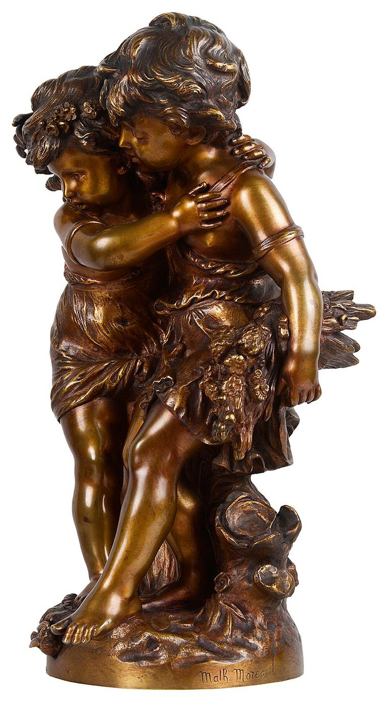 A very pleasing 19th century bronze study of two girls playing, one having a hat and cuddling each other. Signed and number. Math. Moreau.