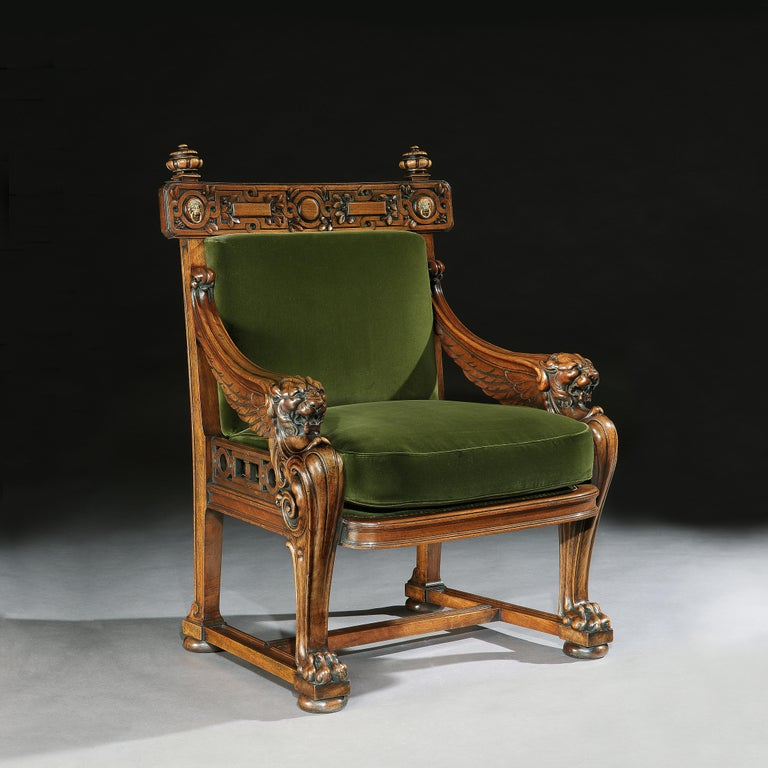 A very fine and impressive European walnut monopodia library armchair, upholstered in a Rosie Uniacke cotton velvet moss, an almost identical armchair having been published in 'English Furniture 1500-1840 by Geoffrey Beard & Judith
