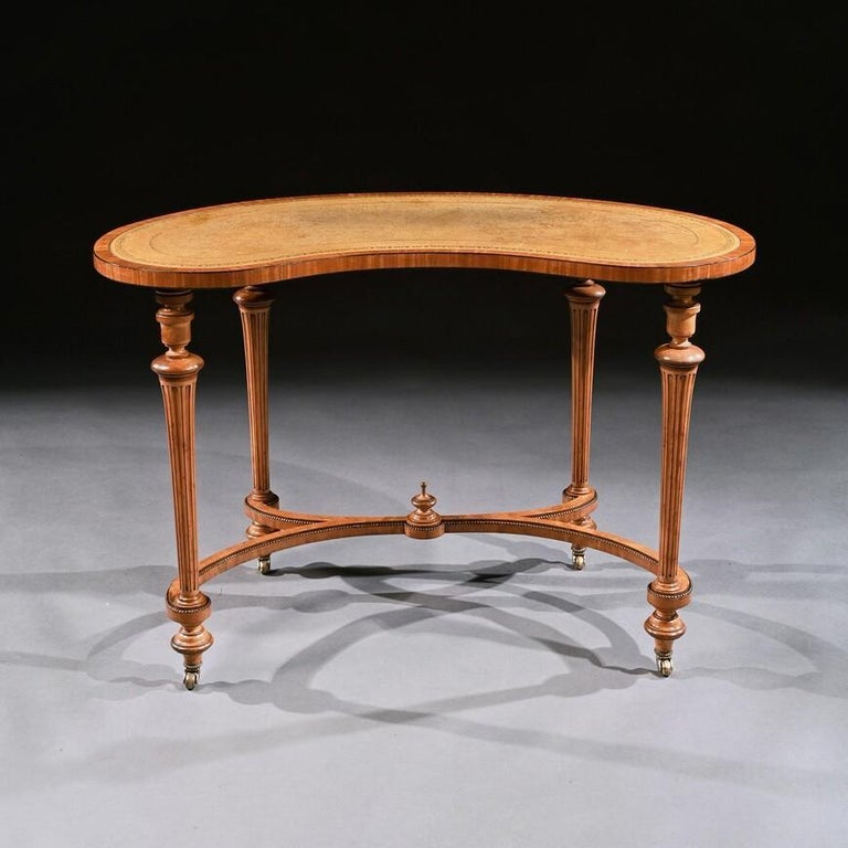 A very fine satinwood and ebony inlaid mid-19th century kidney shaped writing table – side table in the manner of Gillows.