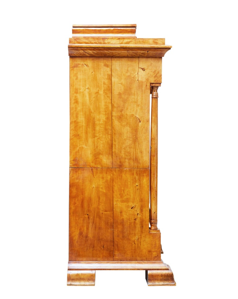 We are pleased to offer this fine secretaire made in birch, circa 1860.  Comprising of two sections. This piece must have been a special commission as it has numerous secret compartments and drawers.  Top section with architectural cornice with