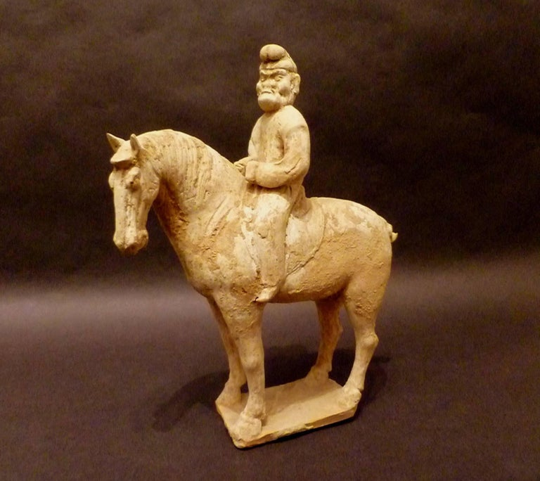 A fine and unusual standing horse with a Persian rider, Tang dynasty 618-907, come with Oxford authentication TL test certificate. Oxford test numbers 106t29.