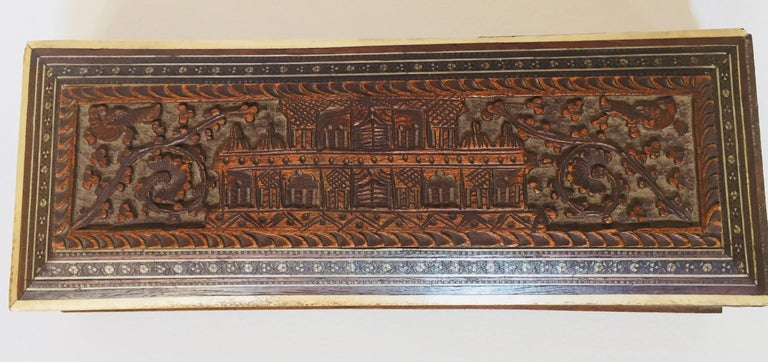 Fine antique Anglo-Indian hand carved wooden jewelry box inlaid with mother of pearl, bone and precious wood. Box handcrafted in very fine Sadeli micro mosaic, and a palace architectural motif design intricately carved. Mother of pearl, satinwood