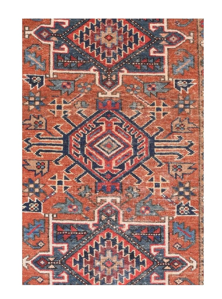 Fine antique Heriz Persian rug, hand knotted, circa 1890  Design: Three Medallion  Heriz rugs are Persian rugs from the area of Heris, East Azerbaijan in northwest Iran, northeast of Tabriz. Such rugs are produced in the village of the same name
