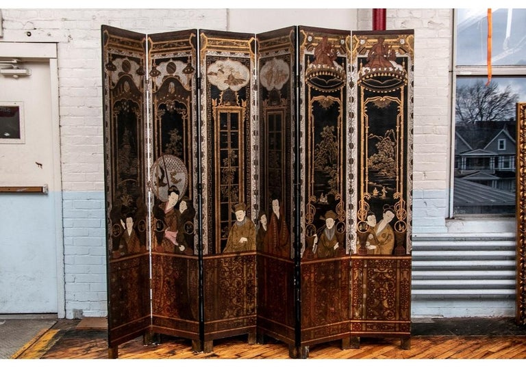 A noteworthy Antique Asian six-panel screen. Elaborately decorated with large male and female figures in architectural settings- gilt frames with views outside, top panels with rocky landscapes with houses in the center, flanked by ones with