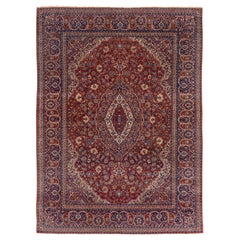 Fine Antique Persian Isfahan Carpet, Red Field, Center Medallion, Blue Accents