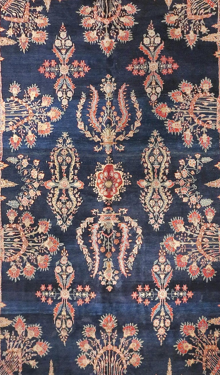 Fine antique Persian rug Farahan Sarouk, hand knotted, circa 1910  Design: Floral, pine trees Color: Navy, beige and sky blue border  Farahan is a village located in west central Iran, north of the city of Arak, and is known for its finely