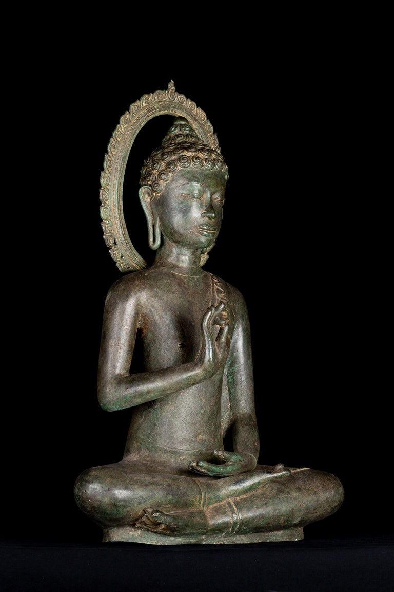 From a forty year old private United Kingdom collection  A Lovely Buddha seated in the padmasana or full lotus position, with his hands raised in front of his chest in the dharmachakra mudra- teaching or preaching the