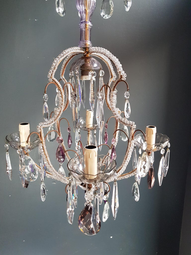 Measures: Total height 99 cm, height without chain 75 cm, diameter 47 cm. Weight (approximately): 7 kg.  Number of lights: 4-light bulb sockets: x E14 and One E27 material: glass, crystal.  Total length variable. Works worldwide  Fine beaded