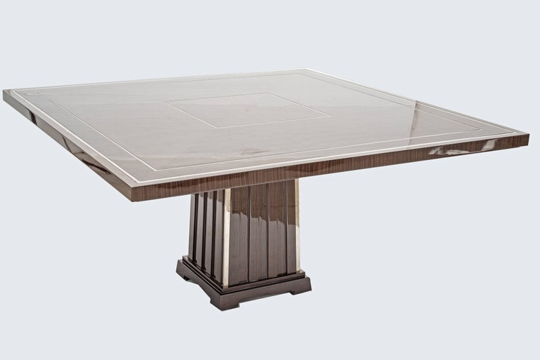 Designed by Monica Ballesio. The top and base are in polished veneer wood with chromed inserts. The table, deco style, is part of a limited edition designed and made exclusively for a prestigious palace in Rome and New York.  Published on the cover