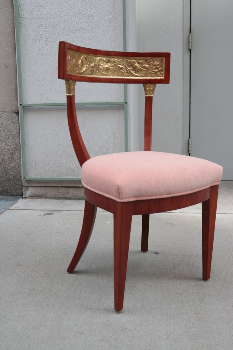 A fine early Biedermeier side chair. Cherrywood with carved giltwood back rest.