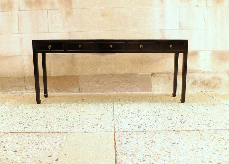 Elegant black lacquer console table with five drawers, brass fitting. Simple form and beautiful color. We carry fine quality furniture with elegant finished and has been appeared many times in