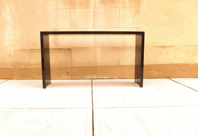 Simple black lacquer console table with waterfall legs, elegant color and lines. We carry fine quality furniture with elegant finished and has been appeared many times in