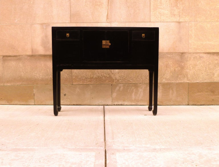 Fine black lacquer console table, very elegant, simple form and beautiful color. We carry fine quality furniture with elegant finished and has been appeared many times in