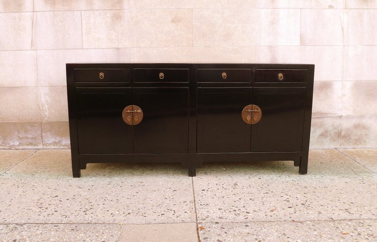 Fine black lacquer sideboard with four drawers and two pair of doors, shelves inside. Elegant and refine piece, simple form and beautiful color. We carry fine quality furniture with elegant finished and has been appeared many times in