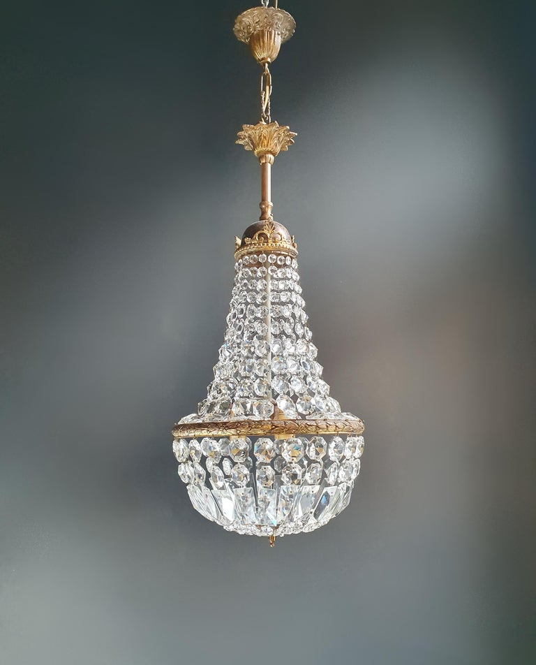 Cabling and sockets completely renewed. Crystal hand knotted Measures: Total height 90 cm, height without chain 67 cm, diameter 30 cm, weight (approximately) 7 kg.  Number of lights: Three-light bulb sockets: E27  Fine brass Empire Sac a pearl