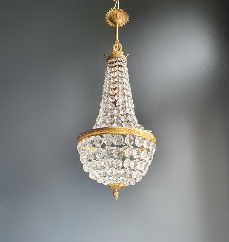 Cabling and sockets completely renewed. Crystal hand knotted Measures: Total height 70 cm, without chain 55 cm, diameter 25 cm, weight (approximately) 4 kg.  Number of lights: One-light bulb sockets: E27  Fine brass Empire Sac a pearl
