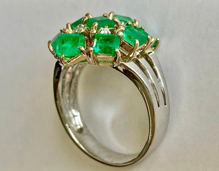 Estate Retro style 4.20 carats natural Colombian emerald, emerald cut, cluster cocktail ring 18K yellow gold handmade setting from our Workshop. Primary Stone: Natural Colombian Emerald Shape or Cut: Mix Cut  Approx Emerald Weight: Over 4.00 Carat