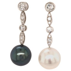Fine Cultured Pearl Earrings in White Gold with Diamonds