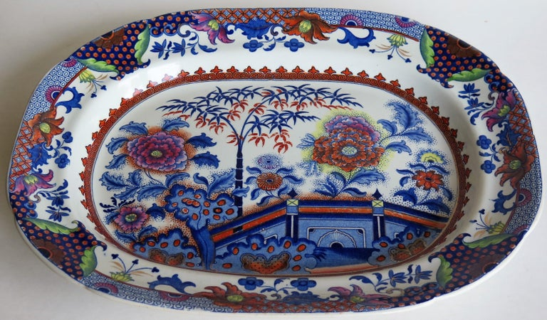 This is a fabulous, late Georgian, mid to large Ironstone Platter from the English Davenport factory, which was situated in Longport, Staffordshire, England between 1794 and 1887.  The oriental garden