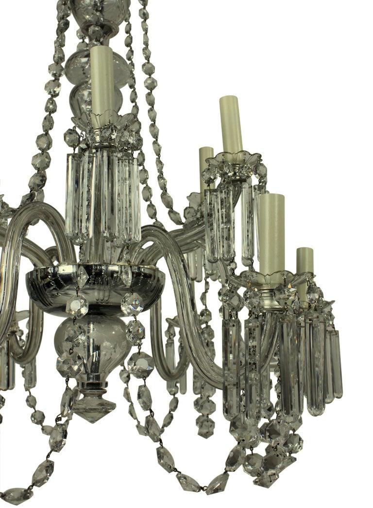 An English Edwardian twelve-branch cut-glass chandelier. Formerly a gasolier, of fine quality.