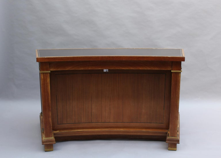Jacques Adnet: A fine French midcentury mahogany curved desk with a leather top and bronze details. Provenance: Palais des Consuls of Rouen, France. 2 rectangular desks with a similar design and from the same provenance are also available (ref. #