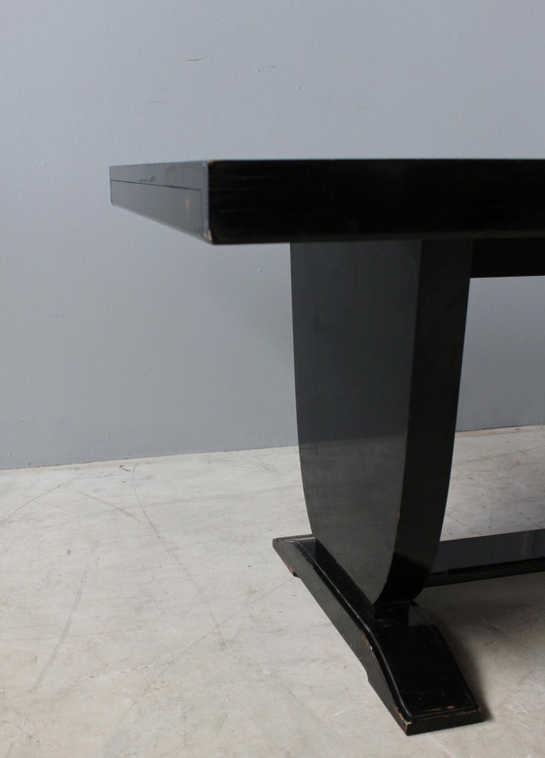 A Fine French Art Deco Black Lacquered Dining Table 6
