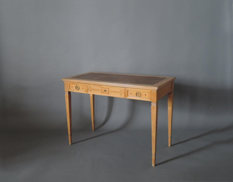 In sycamore, with three drawers, refined gilded bronze handles, floral stencil details and original leather top.      Signed R. Damon & Bertaux, Paris - on desk and chairs.